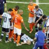 Photo - Argentina's Javier Mascherano lies on the ground after clashing head to head with a dutch player during the World Cup semifinal soccer match between the Netherlands and Argentina at the Itaquerao Stadium in Sao Paulo Brazil, Wednesday, July 9, 2014. (AP Photo/Hassan Ammar)