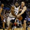 NBA BASKETBALL CHAMPIONSHIP: New Jersey Nets\' Aaron Williams, right, fouls San Antonio Spurs\' Malik Rose, left, as Rose drives to the basket during the first quarter of Game 1 of the NBA Finals in San Antonio, Wednesday, June 4, 2003. (AP Photo/Donna McWilliam)