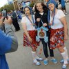 Kent Walstad takes a picture of his daughter, Sydney Walstad, middle, with Vanessa Shadix, left, and Cheri Rich, right, who are dressed in Thunder-themed Swiss costumes before Game 5 in the first round of the NBA playoffs between the Oklahoma City Thunder and the Houston Rockets at Chesapeake Energy Arena in Oklahoma City, Wednesday, May 1, 2013. The women wore the costumes to root for Swiss Thunder player Thabo Sefolosha. Photo by Nate Billings, The Oklahoman