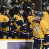 Photo - Nashville Predators defenseman Shea Weber (6) celebrates with his team after scoring a goal against the New Jersey Devils in the first period of an NHL hockey game on Friday, Jan. 31, 2014, in Nashville, Tenn. (AP Photo/Mark Zaleski)
