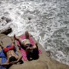 Andrew Panganibgan and Hollie Yang take in some sunshine overlooking the ocean Friday, Sept. 18, 2015, in San Diego. After a short respite and even a bit of rain this week, Southern California is again bracing for more high temperatures through the weekend. (AP Photo/Gregory Bull)