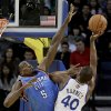 Oklahoma City Thunder\'s Kendrick Perkins, left, defends against Golden State Warriors\' Harrison Barnes (40) during the first half of an NBA basketball game Wednesday, Jan. 23, 2013, in Oakland, Calif. (AP Photo/Ben Margot)