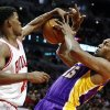 Chicago Bulls forward Jimmy Butler (21) knocks the ball from the hands of Los Angeles Lakers forward Metta World Peace during the first half of an NBA basketball game, Monday, Jan. 21, 2013, in Chicago. (AP Photo/Charles Rex Arbogast)