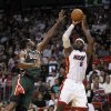 Photo -   Miami Heat's LeBron James (6) prepares to shoot as Milwaukee Bucks' Ekpe Udoh, left, defends in the first half of an NBA basketball game, Wednesday, Nov. 21, 2012, in Miami. (AP Photo/Alan Diaz)