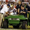 West Virginia\'s Doug Rigg is taken from the field on a stretcher during the second half of a college football game between the University of Oklahoma Sooners (OU) and the West Virginia University Mountaineers at Gaylord Family-Oklahoma Memorial Stadium in Norman, Okla., on Saturday, Sept. 7, 2013. Photo by Steve Sisney, The Oklahoman