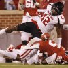 Texas Tech\'s D.J. Johnson (12) forces a fumble on Oklahoma\'s Ryan Broyles (85) during the college football game between the University of Oklahoma Sooners (OU) and Texas Tech University Red Raiders (TTU) at the Gaylord Family-Oklahoma Memorial Stadium on Saturday, Oct. 22, 2011. in Norman, Okla. Photo by Chris Landsberger, The Oklahoman