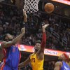 Cleveland Cavaliers\' C.J. Miles, center, shoots over Detroit Pistons\' Andre Drummond, left, and Detroit Pistons\' Corey Maggette during the second quarter of an NBA basketball game Saturday, Dec. 8, 2012, in Cleveland. (AP Photo/Tony Dejak)