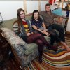Photo - From left, Lara Russo, Cally Guasti and Reese Werkhoven sit on a couch in their apartment in New Paltz, N.Y. on Thursday, May 15, 2014. The roommates had purchased it at a Salvation Army store and found $40,800 stashed inside. After finding a deposit slip, they returned the money to the 91-year-old upstate New York widow who had hidden it there. (AP Photo/Mike Groll)