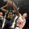New York Knicks\' Steve Novak (16) fights for a rebound against Utah Jazz\'s Alec Burks (10) and Marvin Williams (2) during the first half of an NBA basketball game on Saturday, March 9, 2013, at Madison Square Garden in New York. (AP Photo/Mary Altaffer)