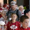 Shelby Schumacher, 13, from Grapevine, Texas, waits in line during the Meet the Sooners event inside Gaylord Family/Oklahoma Memorial Stadium at the University of Oklahoma on Saturday, Aug. 4, 2012, in Norman, Okla. Photo by Steve Sisney, The Oklahoman