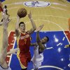 Houston Rockets\' Jeremy Lin, center, goes up for a shot between Philadelphia 76ers\' Spencer Hawes, left, and Evan Turner in the first half of an NBA basketball game, Saturday, Jan. 12, 2013, in Philadelphia. (AP Photo/Matt Slocum)