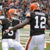Photo - Cleveland Browns quarterback Brandon Weeden (3) celebrates with wide receiver Josh Gordon (12) after they connected on a 21-yard touchdown pass against the Jacksonville Jaguars in the second quarter of an NFL football game on Sunday, Dec. 1, 2013, in Cleveland. (AP Photo/David Richard)