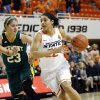 Oklahoma State\'s Brittney Martin (22) gets by Vermont\'s Gracia Hutson (23) during the women\'s college basketball game between Oklahoma State University and Vermont at Gallagher-Iba Arena in Stillwater, Okla., Sunday,Dec. 16, 2012. Photo by Sarah Phipps, The Oklahoman