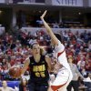 Photo - Iowa forward Kali Peschel, left, drives the base line under Nebraska guard Rachel Theriot in the first half of an NCAA college basketball game in the finals of the Big Ten women's tournament in Indianapolis, Sunday, March 9, 2014. (AP Photo/Michael Conroy)