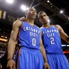 Oklahoma City\'s Russell Westbrook (0) and Thabo Sefolosha (2) talk during Game 4 of the NBA Finals between the Oklahoma City Thunder and the Miami Heat at American Airlines Arena, Tuesday, June 19, 2012. Photo by Bryan Terry, The Oklahoman