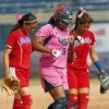 Amber Freeman (9) of the United States is helped around the bases by Galis Lozada (2), left, and Dayanira Diaz (1) of Puerto Rico after Freeman hurt herself running the bases on a home run in the fifth inning during a game in the World Cup of Softball between the USA and Puerto Rico at ASA Hall of Fame Stadium in Oklahoma City, Sunday, July 14, 2013. Team USA won, 10-3 in five innings. Photo by Nate Billings, The Oklahoman