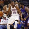 Oklahoma City\'s Kevin Durant (35) works the ball against Sacramento\'s Terrence Williams (55) during the NBA basketball game between the Oklahoma City Thunder and the Sacramento Kings at Chesapeake Energy Arena in Oklahoma City, Friday, April 13, 2012. Oklahoma City won, 115-89. Photo by Nate Billings, The Oklahoman