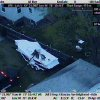 This Friday, April 19, 2013 image made available by the Massachusetts State Police shows a police vehicle probing the boat where 19-year-old Boston Marathon bombing suspect, Dzhokhar Tsarnaev, was hiding in Watertown, Mass. He was pulled, wounded and bloody, from the boat parked in the backyard of a home in the Greater Boston area. (AP Photo/Massachusetts State Police) ORG XMIT: NY117