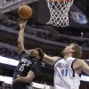 Photo - Minnesota Timberwolves forward Corey Brewer (13) drives against Dallas Mavericks forward Dirk Nowitzki (41) of Germany during the first half an NBA basketball game Wednesday, March 19, 2014, in Dallas. (AP Photo/LM Otero)