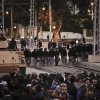 Egyptian riot police stand guard, background, as protesters chant anti-Muslim Brotherhood slogans during a demonstration in front of the presidential palace in Cairo, Egypt, Friday, Dec. 7, 2012. Egypt\'s political crisis spiraled deeper into bitterness and recrimination on Friday as large crowds of the Egyptian President Mohammed Morsi\'s opponents marched to his palace to increase pressure after he rejected their demands. (AP Photo/Nariman El-Mofty)