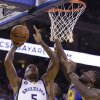 Photo -   Memphis Grizzlies' Marreese Speights (5) shoots against Golden State Warriors' Festus Ezeli (31) during the first half of an NBA basketball game Friday, Nov. 2, 2012, in Oakland, Calif. (AP Photo/Ben Margot)