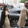 Photo - FILE - In this May 21, 2014 file photo, Kim Kardashian and U.S rap singer Kanye West arrive at a luxury shop in Paris. Before exchanging vows, the two held court in Paris, paraded for photographers and posted photos on Instagram from fashion designer Valentino's 17th-century Chateau de Wideville. There were costume changes, including a sexy open-front white number for the new Ms. Kardashian West. (AP Photo/Jacques Brinon, File)