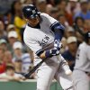 Photo - New York Yankees' Alex Rodriguez hits a single in the seventh inning of a baseball game against the Boston Red Sox, Sunday, Aug. 18, 2013, in Boston. (AP Photo/Michael Dwyer)