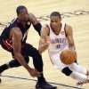 Oklahoma City\'s Russell Westbrook (0) drives past Miami\'s Dwyane Wade (3) during Game 2 of the NBA Finals between the Oklahoma City Thunder and the Miami Heat at Chesapeake Energy Arena in Oklahoma City, Thursday, June 14, 2012. Photo by Chris Landsberger, The Oklahoman