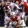 Nebraska\'s Matt O\'Hanlon (33) pulls down an interception over Oklahoma\'s Dejuan Miller (24) and Adron Tennell (80) during the second half of the college football game between the University of Oklahoma Sooners (OU) and the University of Nebraska Cornhuskers (NU) on Saturday, Nov. 7, 2009, in Lincoln, Neb. Photo by Chris Landsberger, The Oklahoman