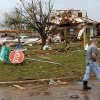 A man walks passed a destroyed home at SW 149th and Stone Meadows Dr. after a tornado struck south Oklahoma City and Moore, Okla., Monday, May 20, 2013. Photo by Nate Billings, The Oklahoman