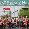 Runners sprint off the starting line of the 14th Annual Oklahoma City Memorial Marathon in Oklahoma City, Sunday, April 27, 2014. The marathon was delayed over two hours beyond it\'s original start time of 6 a.m. Photo by KT King/The Oklahoman