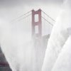 Photo -   The Phoenix fireboat sprays plumes of water as part of the Golden Gate Bridge's 75th anniversary celebration on Sunday, May 27, 2012, in San Francisco. The commemoration included a vintage boat parade and a fireworks display slated for the evening. (AP Photo/Noah Berger)