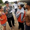 Shawna Scott, second from left, tries to help Jeanett McAllister, second from right, and McAllister\'s son, Tonice Woods, find McAllister\'s two nieces, Sabrina and Olivia Durkey, who are students at Briarwood Elementary, after a tornado struck south Oklahoma City and Moore, Okla., Monday, May 20, 2013. At left is Feliciana Hernando, Scott\'s niece. Scott has a home daycare near SW 156th and Vicki and went to Briarwood to pick up one of the children she watches. She took a group of students from the destroyed school to her home to wait for their parents. Photo by Nate Billings, The Oklahoman