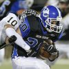 Deer Creek\'s Brennan Miyake is brought down by McAlester\'s Nick Eldridge during a high school football playoff game at Deer Creek, Friday, Nov. 16, 2012. Photo by Bryan Terry, The Oklahoman