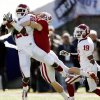 Oklahoma\'s Quinton Carter (20) intercepts a pass in front of Stanford\'s Ryan Whalen (8) during the first half of the Brut Sun Bowl college football game between the University of Oklahoma Sooners (OU) and the Stanford University Cardinal on Thursday, Dec. 31, 2009, in El Paso, Tex. Photo by Chris Landsberger, The Oklahoman