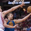 Golden State Warriors\' David Lee (10) drives by Houston Rockets\' Omer Asik, left, during the first quarter of an NBA basketball game, Tuesday, Feb. 5, 2013, in Houston. (AP Photo/Dave Einsel)