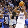 Oklahoma City\'s Kevin Durant (35) takes the game-winning shot over Jason Terry (31) of Dallas as time expires in an NBA basketball game between the Oklahoma City Thunder and the Dallas Mavericks at Chesapeake Energy Arena in Oklahoma City, Thursday, Dec. 29, 2011. Oklahoma City won, 104-102. Photo by Nate Billings, The Oklahoman