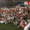 Photo - The OU team poses for a photo after the Fiesta Bowl college football game between the University of Oklahoma Sooners and the University of Connecticut Huskies in Glendale, Ariz., at the University of Phoenix Stadium on Saturday, Jan. 1, 2011.  Photo by Bryan Terry, The Oklahoman O