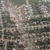 This aerial photo shows the remains of homes hit by a massive tornado in Moore, Okla., Monday May 20, 2013. A tornado roared through the Oklahoma City suburbs Monday, flattening entire neighborhoods, setting buildings on fire and landing a direct blow on an elementary school. (AP Photo/Steve Gooch) ORG XMIT: OKOKL109