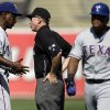 Photo -   Texas Rangers manager Ron Washington, left, argues a force out call with second base umpire Lance Barksdale in the third inning of a baseball game against the Oakland Athletics, Wednesday, Oct. 3, 2012, in Oakland, Calif. At right is Nelson Cruz. (AP Photo/Ben Margot)