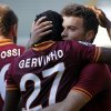 Photo - AS Roma's forward Adem Ljajic, center, of Serbia, is hugged by his teammate Gervinho, of Ivory Coast, center, after he scored during a Serie A soccer match against Hellas Verona at the Bentegodi stadium in Verona, Italy, Sunday, Jan. 26, 2014. (AP Photo/Felice Calabro')