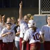 Tuttle players celebrate the Lady Tigers\' first score as teammate Kayla Gripe comes into the dugout after crossing home plate in Class 4A game of the state high school fast-pitch softball tournament at ASA Hall of Fame Stadium, Friday afternoon, Oct. 10, 2008. Tuttle won in 8 innings. BY JIM BECKEL, THE OKLAHOMAN