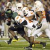 Oregon\'s LeGarrette Blount (9) gets past OSU\'s T.J. Bell (11), Jacob Lacey (17), Orie Lemon (41) and Andre Sexton (20) on a touchdown run in the fourth quarter of the Holiday Bowl college football game between Oklahoma State and Oregon at Qualcomm Stadium in San Diego, Tuesday, Dec. 30, 2008. Oregon won, 42-31. PHOTO BY NATE BILLINGS, THE OKLAHOMAN