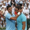 Photo - Spain's Rafael Nadal, right, is congratulated by Serbia's Novak Djokovic after winning the final of the French Open tennis tournament at the Roland Garros stadium, in Paris, France, Sunday, June 8, 2014. Nadal won in four sets 3-6, 7-5, 6-2, 6-4. (AP Photo/Michel Euler)