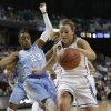 Photo - Duke's Tricia Liston, right, pushes North Carolina's Diamond DeShields, left, as she drives to the basket during the first half of an NCAA college basketball semi-final game at the Atlantic Coast Conference tournament in Greensboro, N.C., Saturday, March 8, 2014. Liston was called for a foul on the play. (AP Photo/Chuck Burton)