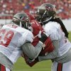 Tampa Bay Buccaneers guard Davin Joseph (a former Sooner), right, blocks tackle Demar Dotson during the NFL football team\'s training camp Saturday, July 27, 2013, in Tampa, Fla. (AP Photo/Chris O\'Meara)