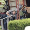 An Oklahoma City Police officer pins a suspect to the ground after he was taken into custody in connection to the robbery of MidFirst Bank in Oklahoma City , Friday April 12, 2013. Police and FBI agents surround a home at 3024 NE 16th street where the suspects were hiding. Photo By Steve Gooch, The Oklahoman