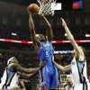 Oklahoma City\'s Serge Ibaka (9) moves to the hoop between Memphis\' Zach Randolph (50), Jerryd Bayless (7) and Tayshaun Prince (21) during Game 3 in the second round of the NBA basketball playoffs between the Oklahoma City Thunder and Memphis Grizzles at the FedExForum in Memphis, Tenn., Saturday, May 11, 2013. Photo by Nate Billings, The Oklahoman