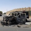 This photo taken on Tuesday, July 1, 2014, shows destroyed police trucks after clashes between fighters of the al-Qaida-inspired Islamic State of Iraq and the Levant and Iraqi security forces in central Tikrit, 80 miles (130 kilometers) north of Baghdad, Iraq. The Islamic State of Iraq and the Levant announced this week that it has unilaterally established a caliphate in the areas under its control. It declared the group\'s leader, Abu Bakr al-Baghdadi, the head of its new self-styled state governed by Shariah law and demanded that all Muslims pledge allegiance to him. (AP Photo)