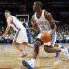 Oklahoma City\'s Reggie Jackson (15) dribbles the ball near Cole Aldrich (45) during the NBA basketball game between the Detroit Pistons and Oklahoma City Thunder at the Chesapeake Energy Arena in Oklahoma City, Monday, Jan. 23, 2012. Oklahoma City won, 99-79. Photo by Nate Billings, The Oklahoman